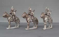 Belgian Chasseurs a Cheval swords shouldered horses stood